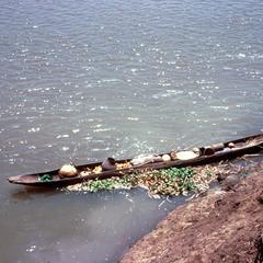 Cargo-laden Pirogue (Canoe) on the River Bank