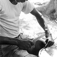 Bucketmaker Hammering on the Bottom