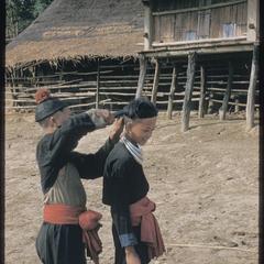 Hmong (Meo) getting haircut