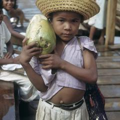 Girl with papaya fruit, Los Chiles