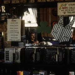 Back bar at Art Altenburg's Concertina Bar with concertinas and food menu