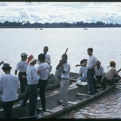 """Boat races : """"horsing around""""--men on pirogue"""