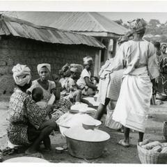 Selling gari at Oshu market