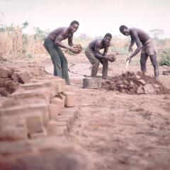 Men Gathering Mud for Bricks