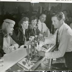 Dennis Morgan serving soft drinks