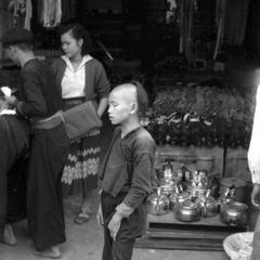 Hmong boy and man in shop