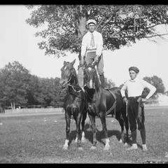 Fair act with men and horses