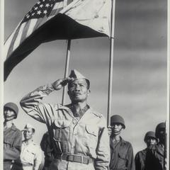 Sgt. Jose Calugas, Philippine Scout, and the first Filipino to be so honored, salutes as he receives the Medal of Honor, Manila, 1945