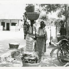 Women with baskets for market