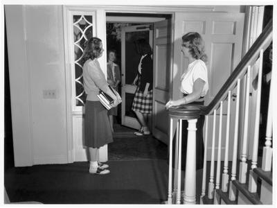 Students in the doorway of the home management house