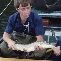 Peter Inskip measuring a northern pike
