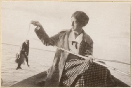 Wife Estella fishing from boat, Fish Lake, Dane County, Wisconsin, July 1925