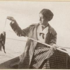 Wife Estella fishing from boat, Fish Lake, Dane County, Wisconsin, July 1925