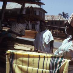 Nike's mother selling cloth at the Plank market