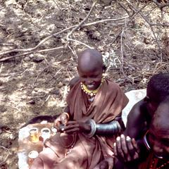 Two Masai Women Stringing Beads
