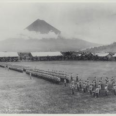 The Fourth Battalion drills with Mt. Mayon in the background, Albay, early 1900s