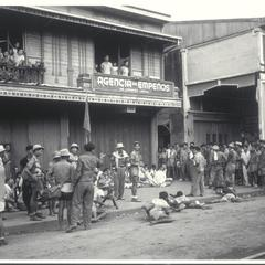 Chinese guerrillas guard captured Japanese, Manila, 1945