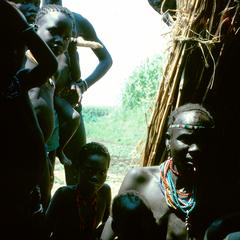 The Visiting Anthropologist is Greeted by Members of the Village