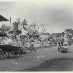 Filipino children carrying bricks, Manila, 1945