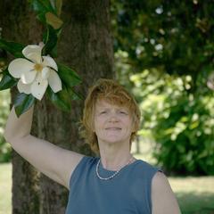 Magnolia grandiflora flower with Bonnie Clayton