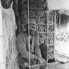 Man Weaving a Mat with Loom