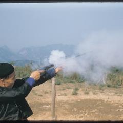 Hmong (Meo) shooting rifle