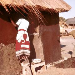 Lozi Women Applying Mud and Dung Stucco to Walls of House in Barotseland