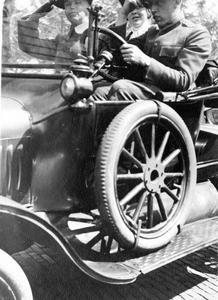 Marie Leopold riding in car with uniformed man