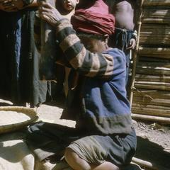 Woman milling rice