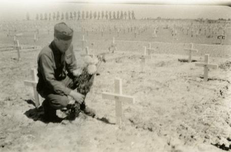 Putting flowers on Jack Holum's grave
