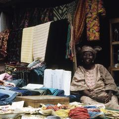 Mrs. Obe with fabric at Ilesa market