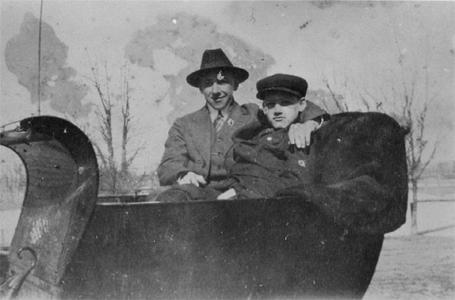 Louis Ropson in a sleigh with a friend