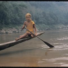 Young bonzes paddling pirogues on the Mekong near Luang Prabang town