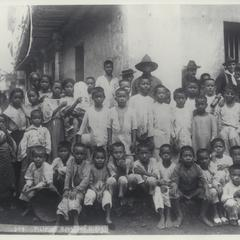 Filipino boys and girls on what is probably Calle Real, Cavite, 1899