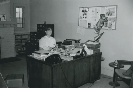 Staff person in the Alumni House (early)