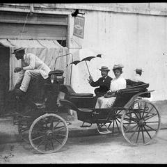 T. E. B. and M. C. B. in carriage