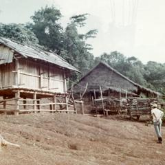 Rice storage buildings in a White Hmong village in Houa Khong Province