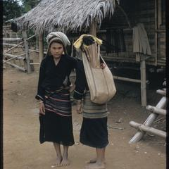 Kammu (Khmu') girls carrying sacks