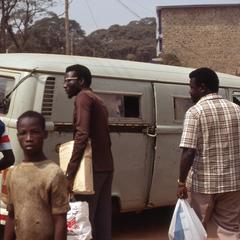 People loading a van