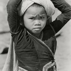 Khmu'-Khuen girl carries a shoulder bag on her head in Houa Khong Province