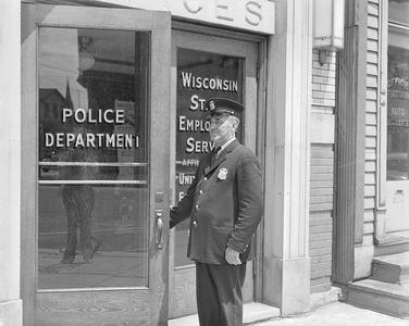 Officer Diegel at Police Department door
