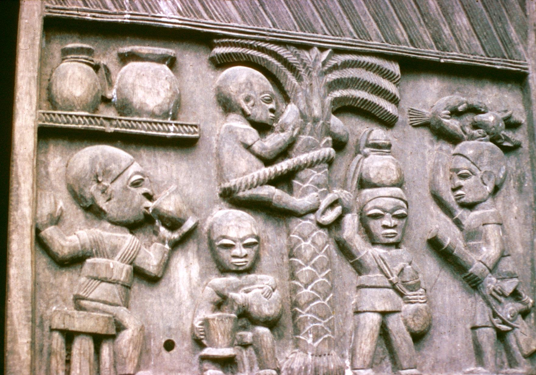 Yoruba Wood Carving Depicting Activities Including Harvest of Coconuts