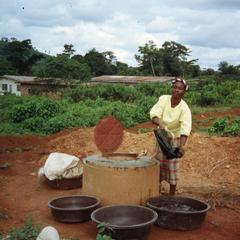Woman getting water for processing gari