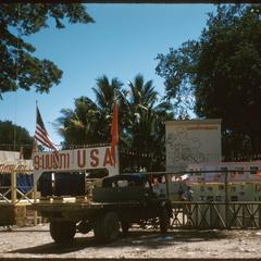 United States Operations Mission (USOM)-USIS booth, map of Laos in background