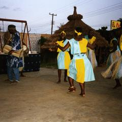 Masquerade dancers in yellow and blue