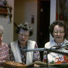Loretta Giese and neighbors sing old German school songs