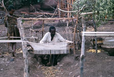 Man Weaving at Pit Loom